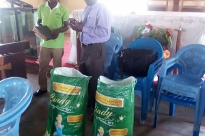 Widows Project Bags of rice distribution in progress