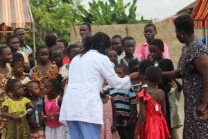 Nurse manager Margaret Ankamah providing dental care with smiles