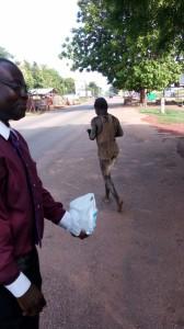 Dr-Ankamah-Feeding-a-homeless-mentally-chalenged- gentlemanGhana-Missions-2016IMG 2390