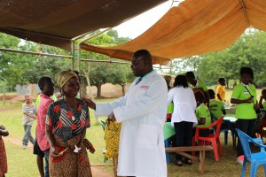 Dr.Ankamah-and-his team-giving-medical-advice-to-a-senior-citizenIMG 0070 (2)