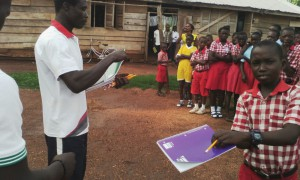 Students-happily-receiving-school-stationery-missions-2016IMG 2413